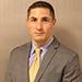 Michael Contos, Esq. – Associate